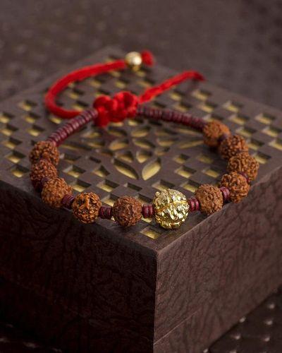 Mahadev Golden Rudraksha Bead in Red Thread